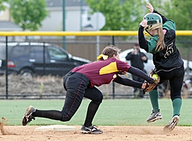 by: Chase Allgood, PLAYOFF PLAY — Jesuit's Alicia Taylor tries to avoid a tag at second base during her team's May 23 playoff loss at Forest Grove.