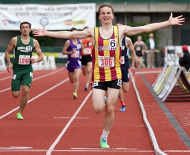 by: Miles Vance, Forest Grove sophomore Geremia Lizier-Zmudzinski raises his arms in celebration as he crosses the finish line at Hayward Field on Saturday.
