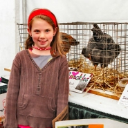 by: David F. Ashton, East Portland 4-H member Ruth Reneauer, who is 7, shows and tells about the chickens her group is raising.