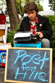 "by: David F. Ashton, ""Street poet"" Tristan Bennett writes his next verse – using carbon paper to save a copy of his poem – on his trusty Remington portable."
