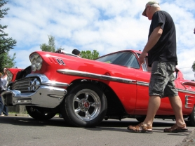 by: Ray Pitz, A visitor to last year's Cruisin' Sherwood car show checks out a 1958 Chevy Impala.