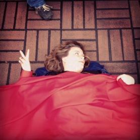 by: Christopher Onstott, Protestors lie under a red carpet along Southwest Morrison Street outside the Governor Hotel Monday afternoon during a fundraiser for Republican presidential candidate Mitt Romney. Romney raised more than $500,000 for his campaign.
