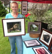 by: Jim Hart, Showing some of her creative photography at the Saturday Boring Farmers Market is Mary Peterson, owner of Northwest Digital Specialties, a home-based business in Gresham.