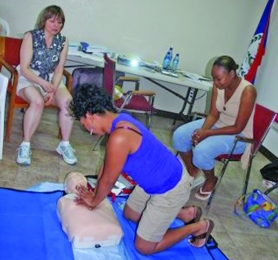 by: sUBMitted photo, Beavercreek resident Lorie Ramey, CPR coordinator for Adventist Medical Center (from left), teaches lifesaving techniques to Marcia Lennen and Areli Carr of Belize.