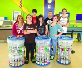 by: Courtesy photo, Scappoose Middle School students pose next to three homemade recycling bins they constructed as a school project. Top Row: Tyler McDowall, Dallas Hamilton, Travis Gardner. Bottom Row: A.J. Banks, Riley Adams, Camika Anderson, Madi Henderson.