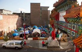by: CHRISTOPHER ONSTOTT, City union employees called for the city to reverse its decision declaring illegal the Right 2 Dream Too homeless encampment beside the Chinatown Gate on West Burnside Street.