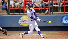 by: STEVEN FRANZ, SERIES SMACK – Heidi Pizer takes her swing during LSU's win over South Florida Saturday at the Women's College World Series.