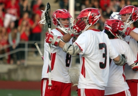 by: MILES VANCE, Lincoln players celebrate after Grant Clifford's first goal of the championship game helped the Cardinals rally for a 7-6 win over Sunset.