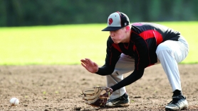 by: Pamplin Media Group, Sandy second baseman Brad Martin fields a ground ball against the Milwaukie Mustangs this season. The Pioneers spent much of their year practicing indoors, and that hurt the team in games.