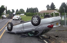 by: Becky Ginsbach/Estacada Eagle, This DHS vehicle flipped on Springwater Road after swerving to avoid a pickup on Thursday.