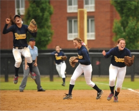 by: zack palmer, Banks softball players (from left) Riley Gerlinger, Hannah Vandomelen and Melissa Masters celebrate the final out of the Lady Braves' 2-0 win over Cascade in the OSAA Class 4A state championship game on Saturday.