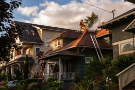 by: Courtesy of PFR, Portland firefighters battled a blaze on Northeast 27th Avenue that injured an 89-year-old woman. The blaze was caused by faulty wiring in the home's second floor.