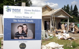 by: Jim Clark, Workers from Reilly Signature Homes help build the house for the Snyder family.