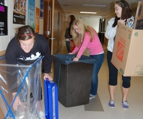 by: raymond Rendleman, Gladstone High School sophomores Meghan Winkle (from left), Cassidy Olsen-Shultz and Jessica Coiteux help sort recycling as part of the Green Club's efforts winning a statewide award.