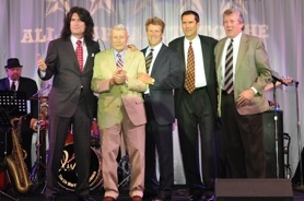 by: sUBMitted photo, Lead KISS guitarist Tommy Thayer, son of retired Brig. Gen. James B. Thayer (second from left), helps get the Clackamas military museum of the ground with his brothers.