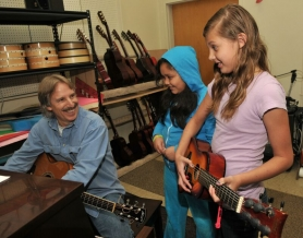 by: Vern Uyetake, John Nilsen gives encouragement to Kaleah Helmke, right, and Yasmeen Gutierrez on becoming a musician during his residency at Bolton Primary School.