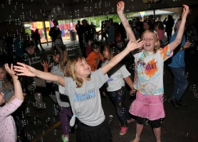 by: Vern Uyetake, Gabriella Dover, left, and Kiersten Weiler enjoy dancing among a flurry of soap bubbles at last Friday's Bryant Palooza.