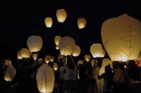 by: SUBMITTED PHOTO, Lakeridge High School seniors released 200 paper lanterns June 7 as a new tradition for the school's graduation celebration.