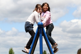 by: Jonathan House, First-grade pen pals Charlie Yates of Tualatin Elementary, left, and Adriana Gonzalez of Aloha-Huber Park K-8 School play together after meeting for the first time on June 6.