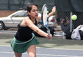 by: Miles Vance, GOT IT — Jesuit's Meghana Rao stretches to make a volley during play in the Class 6A state tennis tournament at Portland Tennis Center on May 18.