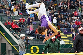 by: Miles Vance, FLIPPING OUT — Sunset's Rocky Tufty leaps onto the pad in celebration after winning the Class 6A state championship in the high jump at Hayward Field in Eugene on May 26.