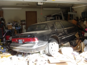 by: Milwaukie Police, A driver of a vehicle slamming into a Milwaukie home on Thursday evening is cited for speeding.