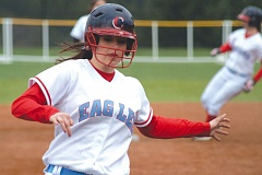 by: THE OUTLOOK: DAVID BALL - Centennial's Karley Buckland sails into third base during Tuesday's 7-1 win over Rex Putnam.