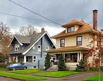 by: EILEEN G. FITZSIMONS - These are two of the eight homes on S.E. 19th, at Claybourne Street, that celebrated their 100th birthdays in September of last year.
