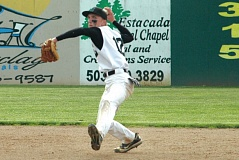 by: ESTACADA NEWS: PARKER LEE - Rangers shortstop Ryan Vauthier makes a throw across the infield.
