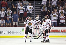 by: TRIBUNE PHOTO: JAIME VALDEZ - Ty Rattie (left) celebrates his goal, which gave the Portland Winterhawks a 3-1 lead over Kamloops.