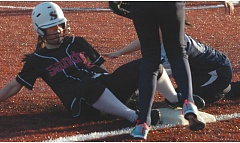 by: SANDY POST: PARKER LEE - Sandys Chelsea Spanier slides into third base.
