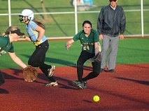 by: MATTHEW SHERMAN - West Linn shortstop Leah Beyer charges a ground ball during the Lions' 7-4 victory over Lakeridge at home on Monday.