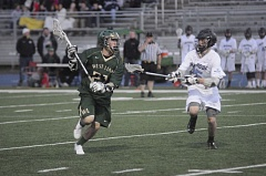 by: MATTHEW SHERMAN - West Linn's Ryan Bowers finds some room as he clears the ball in West Linn's league match with Lakeridge on Tuesday.