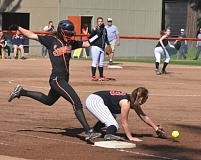 by: JOHN BREWINGTON - Scappoose's Lacey Updike beats out a throw that got away during last week's game with Tillamook.