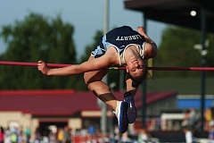 by: HILLSBORO TRIBUNE PHOTO: AMANDA MILES - Liberty junior Elizabeth Pecsok clears 5 feet, 4 inches to take second place in the girls high jump at the 46th annual Elden Kellar Invitational track meet last Friday at Hare Field.
