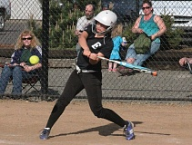 by: PAMPLIN MEDIA GROUP: COLIN STORM - Estacadas Annie Eads takes a swing during Thursdays 9-7 loss to No. 4-ranked Molalla.