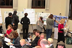 by: DAVID F. ASHTON - Attendees at the third and final Foster Corridor Investment Strategy open house at the Wikman Building near Foster Road at Holgate Boulevard talk with representatives from many City and County Bureaus.
