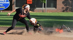 by: JOHN BREWINGTON - Scappoose's Cassidy Hoglund tags a YC runner during Tuesday's game in Scappoose, a 2-1 loss for the Tribe.