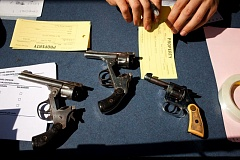 by: PAMPLIN MEDIA GROUP PHOTO: CHRISTOPHER ONSTOTT - Three old revolvers were among the 485 guns turned in Saturday, May 11, during the Ceasefire Oregon event in the Centennial neighborhood.