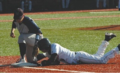 by: SANDY POST: PARKER LEE - Sandys Kevin Frank dives back to first base during Tuesdays home loss to Wilsonville.