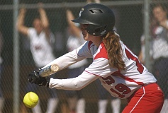 by: SANDY POST: DAVID BALL - Mt. Hoods Heather Jett puts a bunt in play during last weeks 6-3 loss to Clackamas CC in Game 1. The Saints bounced back to take Game 2 by a 10-3 count.