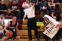 by: JONATHAN HOUSE - Kyle Bracy (center), the head basketball coach at Milwaukie for the past nine seasons, has resigned that position so that he can spend more time with his family.