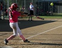 by: JONATHAN HOUSE - Clackamas senior catcher Vanessa Oakden sends the ball for a ride in a recent game. Hitting has been a strong suit for the Cavaliers this season. The Three Rivers League champs sport a .331 team batting average heading into postseason play.