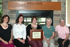 by: ESTACADA NEWS PHOTO: ISABEL GAUTSCHI - Library staff members Laurie Ellicott, Annie Sprague, Michele Kinnamon, Joanne Headrick and Penny Vogel proudly display their certificate of recognition for the librarys 100th year of service.