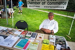 by: NEWS-TIMES PHOTO: CHASE ALLGOOD - Chamber volunteer Ray Giansante was one of several dedicated folks who staffed an information table at the Big Sky meet, along with Chamber Director Howard Sullivan and his wife LaDonna, Mayor Pete Truax and Jeff King, the citys economic development manager. They had loads of good information on local restaurants but few visitors, which may partially account for the uneven economic benefits. The conference was great for Best Western, said Pizza Schmizza owner Ron Bednar, but as far as my weekly totals, you couldnt even see it.