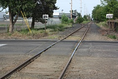 by: NEWS-TIMES PHOTO: DOUG BURKHARDT - Needs work: The Portland & Western Railroads Fourth Street crossing in Cornelius is in bad shape, but a fix is in the works. This summer, in a $198,000 project, the crossing and a section of the tracks that run through it will be rebuilt, with concrete pads being placed where the crumbling asphalt is now. A new sidewalk will be added as well.