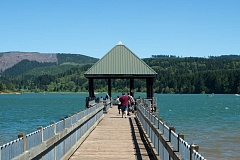 by: NEWS-TIMES PHOTO: CHASE ALLGOOD - Anglers head down the pier at Hagg Lake, one of two Oregon lakes stocked with special tagged fish whose capture can lead to a prize for the lucky fisherperson.