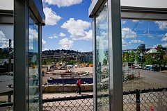 by: TRIBUNE PHOTO: CHRISTOPHER ONSTOTT - OMSI's surplus property, shown through a new streetcar stop, is being used for staging construction equipment, but the museum hopes to turn it into a money-making development.