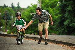 by: TRIBUNE PHOTO: CHRISTOPHER ONSTOTT - Seven-year-old Thalen Abadia and his dad, Teos, were among 12,000 residents who participated in the citys Sunday Parkways festivities on Mothers Day.