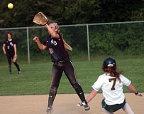 by: DAN BROOD - IN ACTION -- Sherwood sophomore shortstop Katie Zook (left) reaches for the ball as Putnam freshman Elysia Webb slides to second base in Friday's game.
